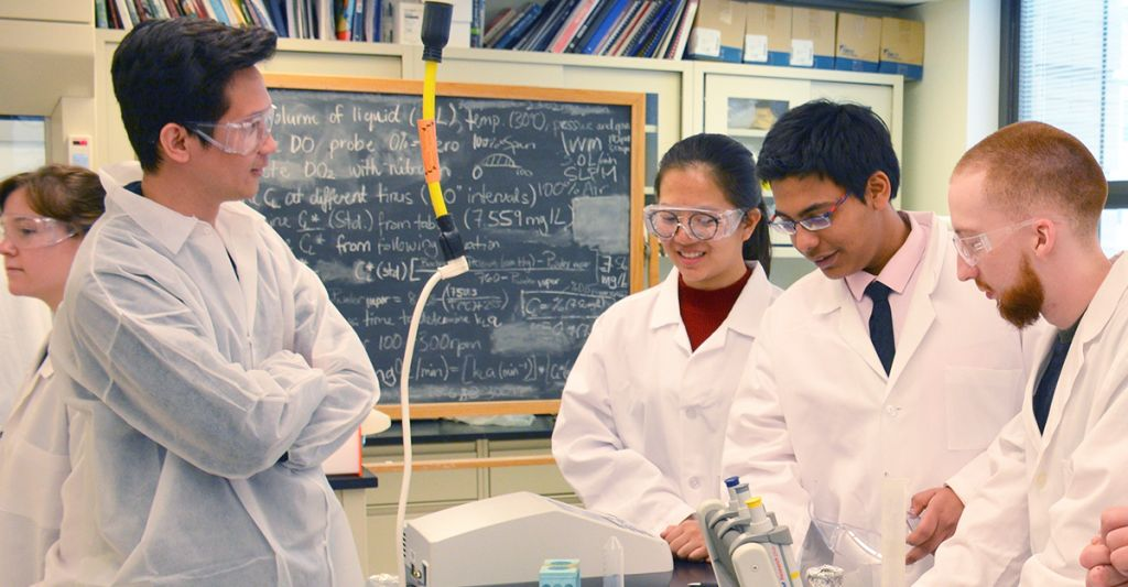Biotechnology students working in a lab