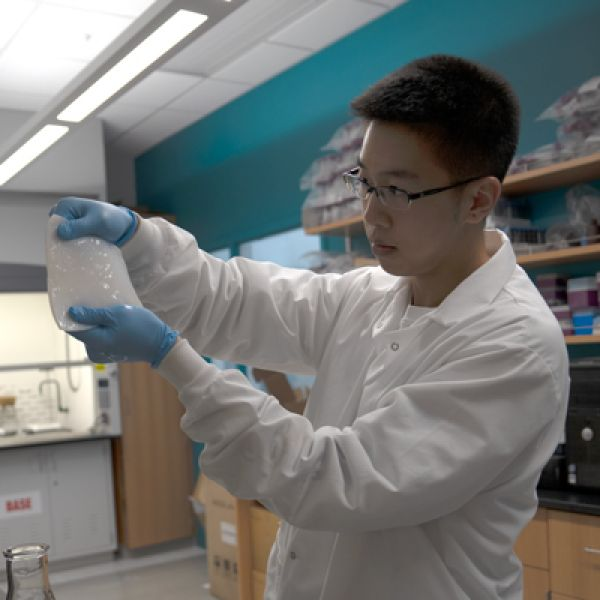 Hetian Hu, Agricultural and Biological Engineering, holds bacterial cellulose.